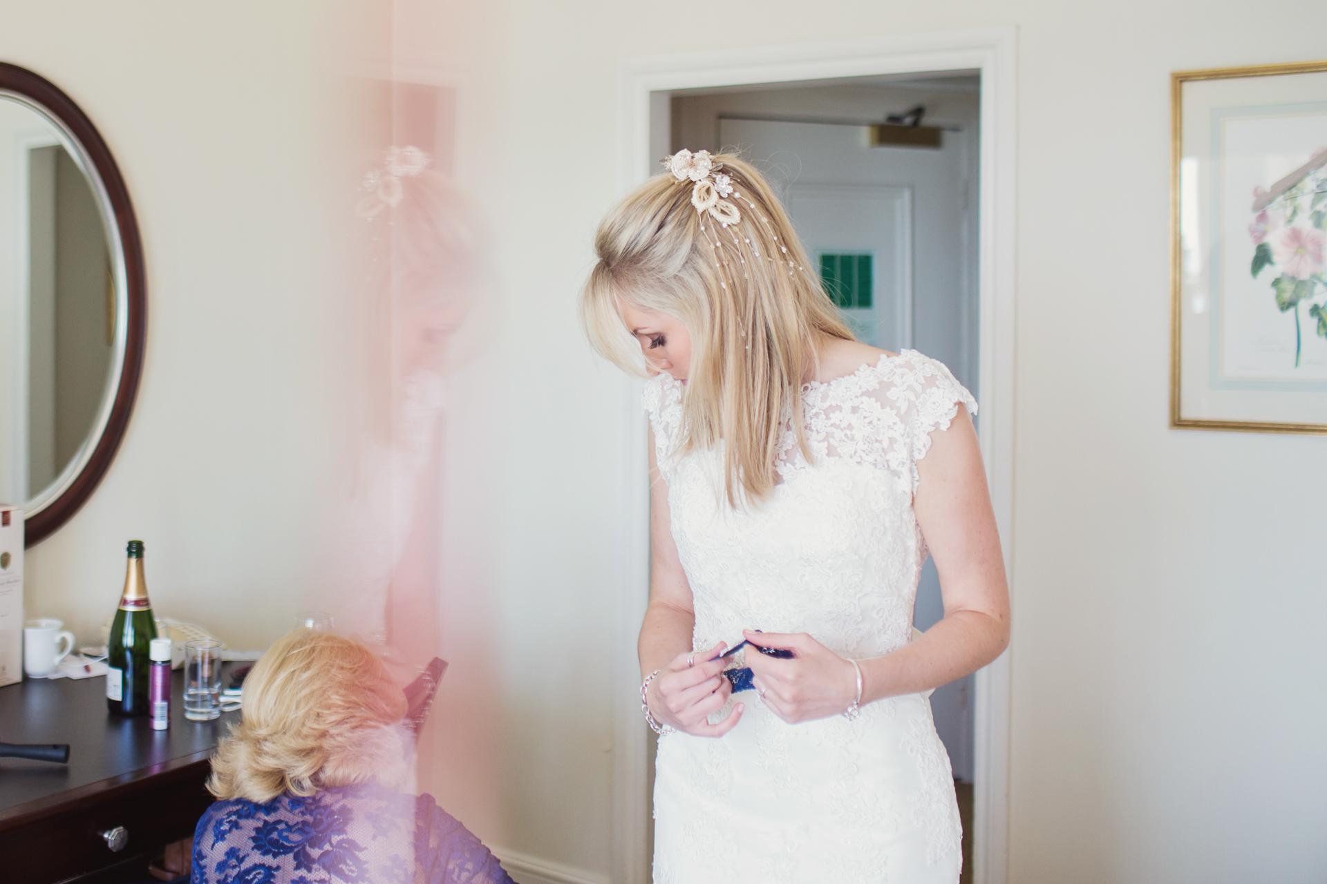 bride getting ready to marry beach wedding