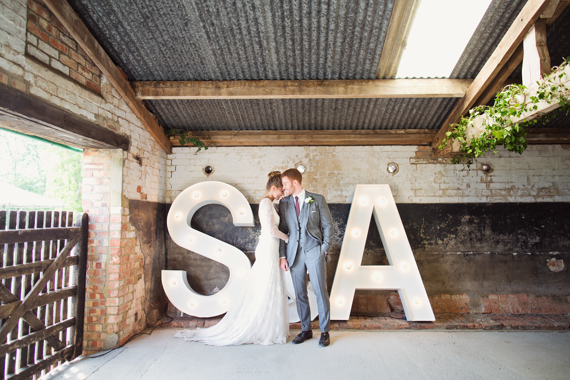 barn wedding photographer with giant letters