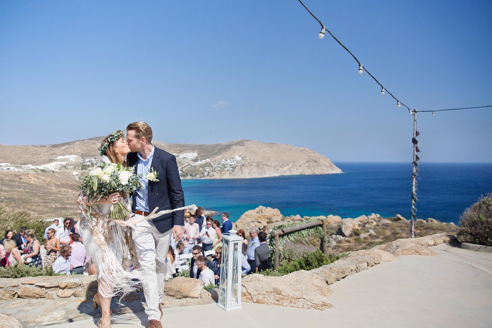 mykonos wedding photographer over the sea on a cliff top