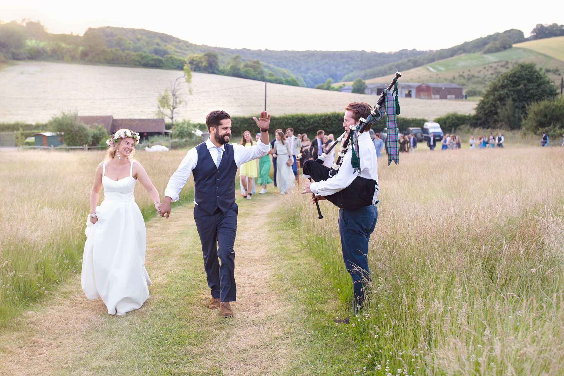 Bagpipe led bridal procession at Upwaltham Barns in Chichester